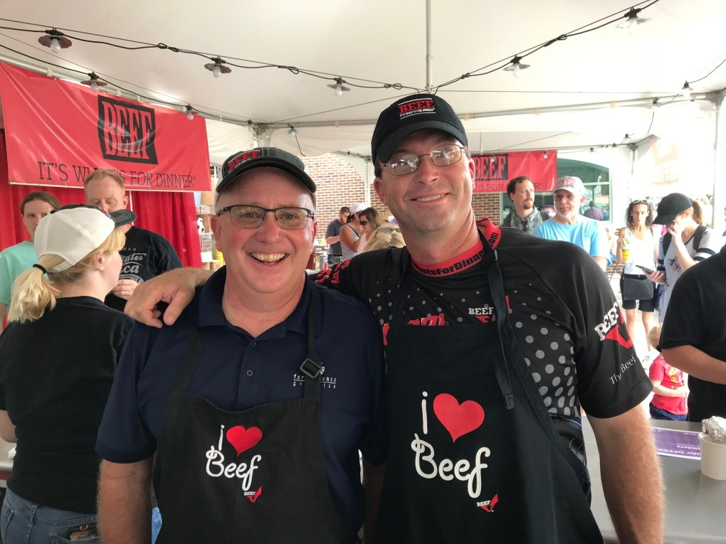 Treasurer Miles Kuhn and President Jason Tower are happy to serve beef.