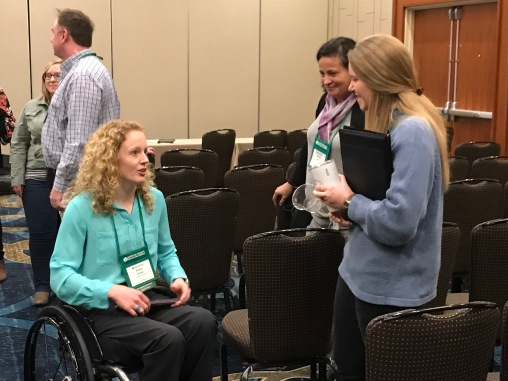 Shelby Gruss (left) interacts with two forage scientists from North Dakota State University after completion of the Emerging Scientist Competition.