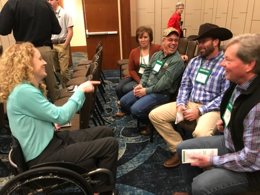 Rose and Clay Nuhring, Jason Tower, and Greg Downing share a light hearted moment with Shelby after her outstanding presentation.